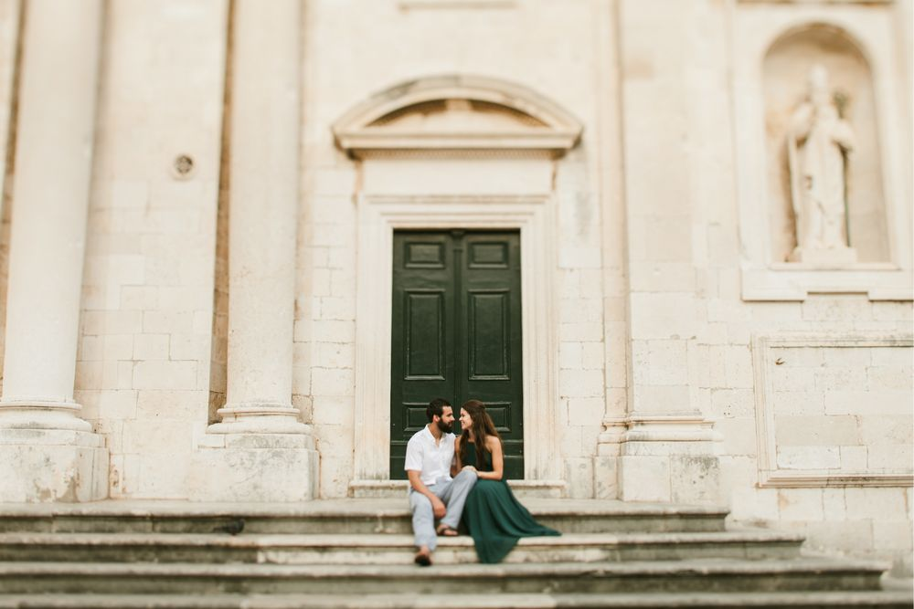 A Newlyweds sitting on old stairs of Dubrovnik Cathedral