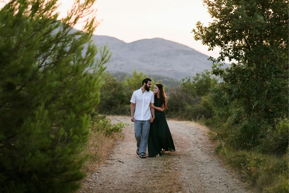 Early morning sun rise with the birds chirping away. The newly wed couple walking on the Mount Srd.