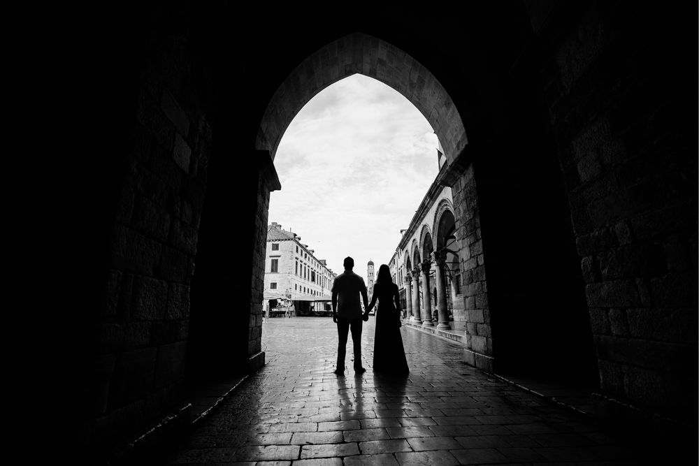 While having a photo session in Dubrovnik, a couple in love is standing at the beginning of the main street of Dubrovnik, called Stradun.