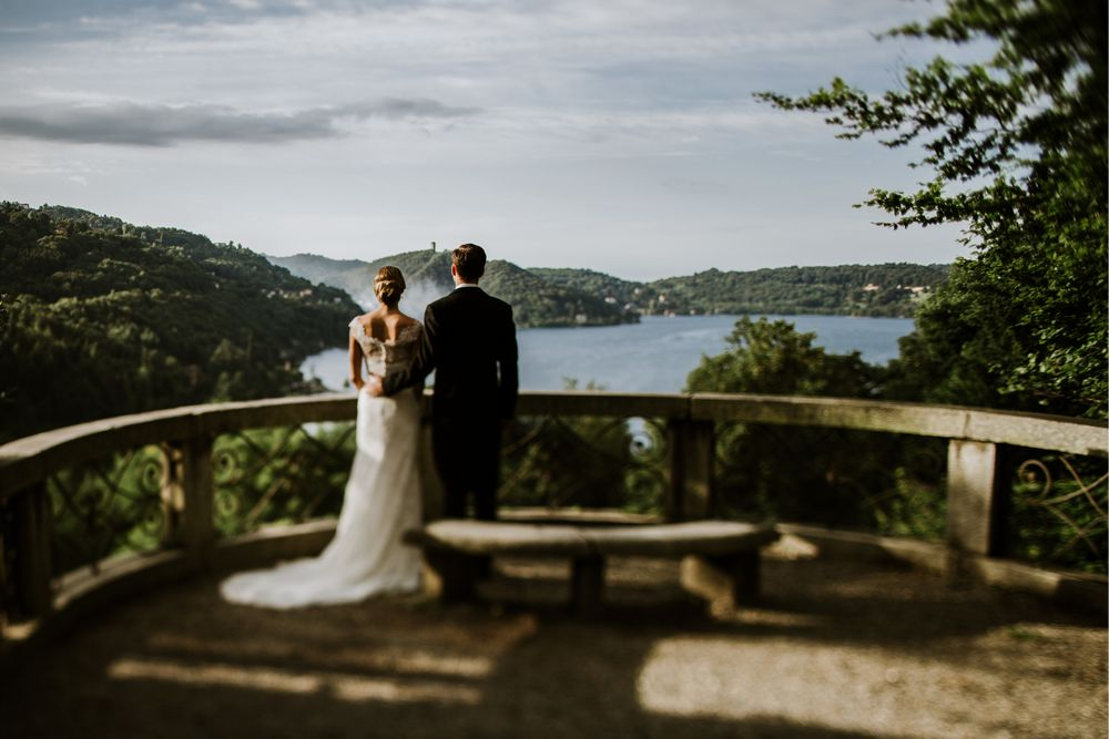 Bride and Groom looking towards the Lake Orta, Photo by DTstudio Italy wedding photographer