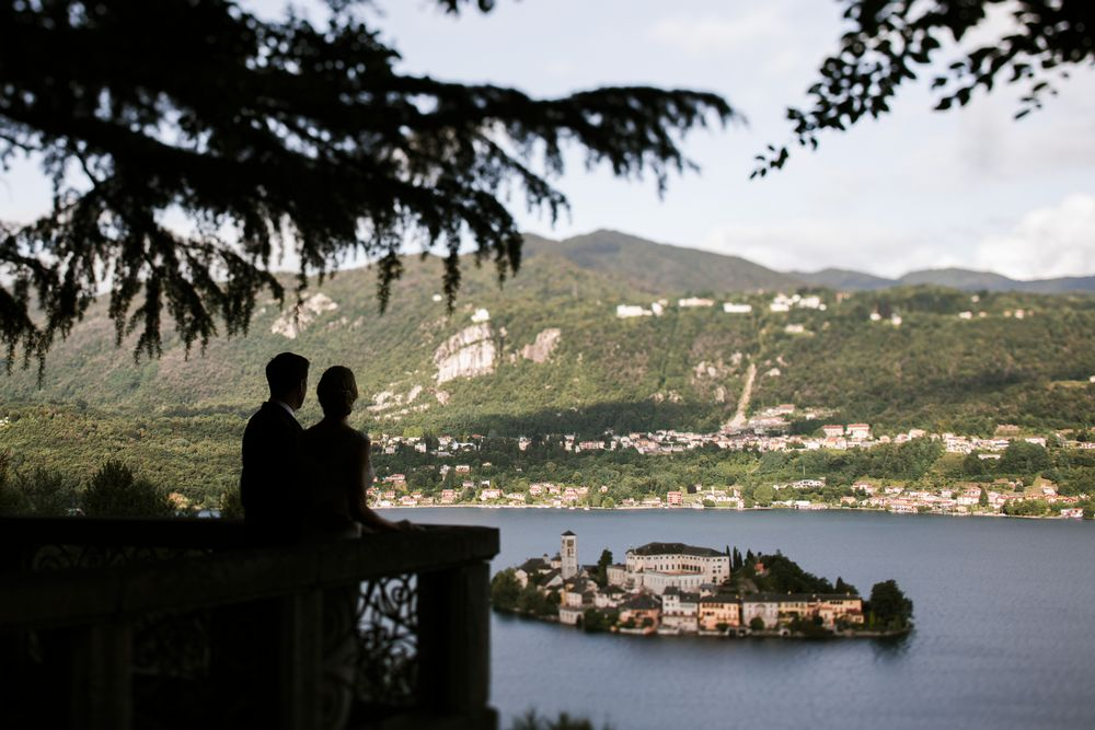 Bride and groom looking towards the San Giulio Island while their wedding weekend in Italy. Photo by DTstudio, Lake Como wedding photographer Lake Orta Wedding Photographer & Videographer