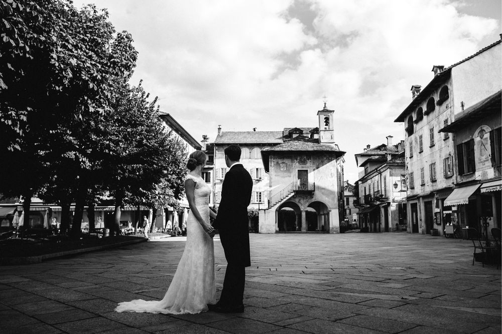 Newlywed couple at Piazza Motta - Italy wedding photographer Lake Orta Wedding Photographer & Videographer