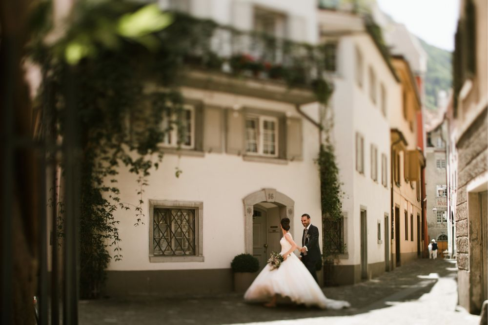 Newlyweds walking down the streets of Chur, Switzerland. Photography by DT studio Switzerland wedding photographer & videographer