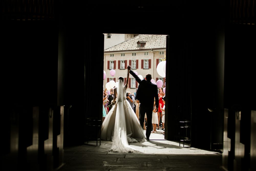 wedding in chur, switzerland - the couple leaving the church