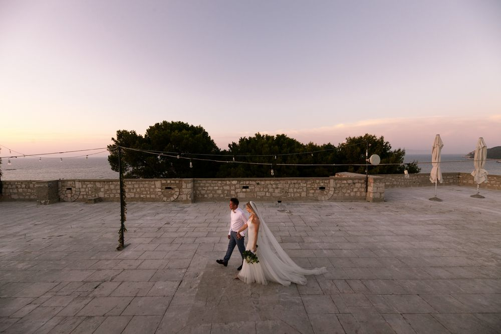 a newlywed couple walking on Fort Gorge rooftop