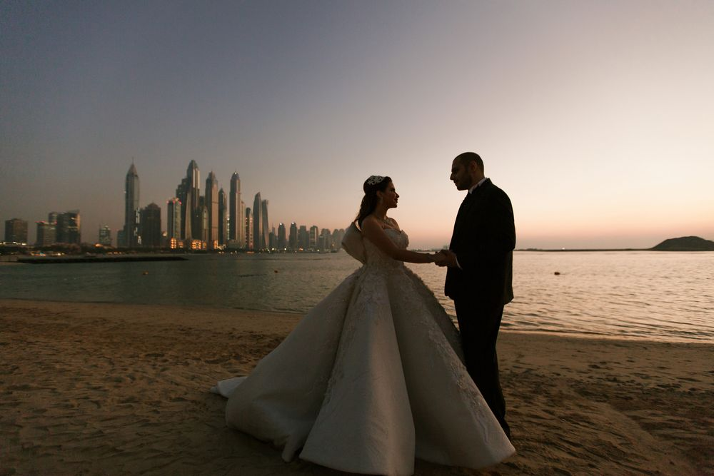 Beautiful beach photo session in Dubai captured by dubai wedding videographer