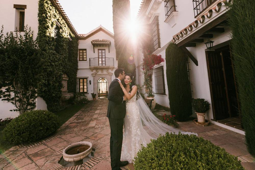 Wedding in Spain. Newlyweds couple posing in front of Marbella wedding photographer