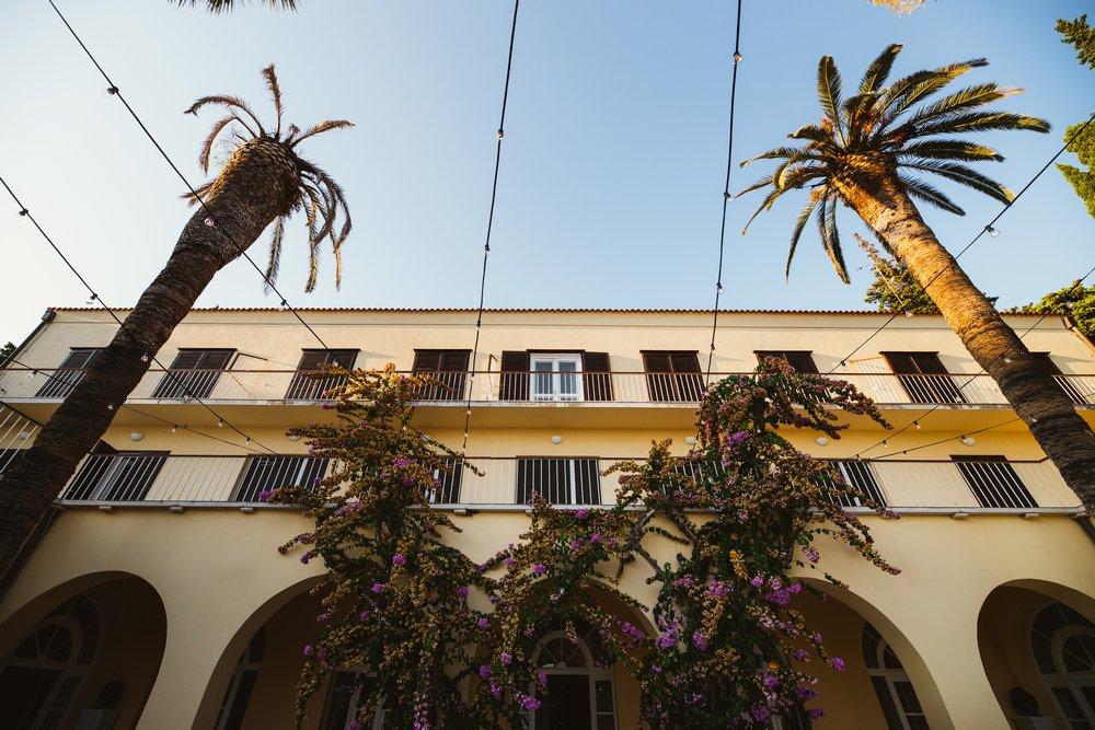 Palm trees and flowers of Villa Dalmacija, wedding Venue in Split, Croatia