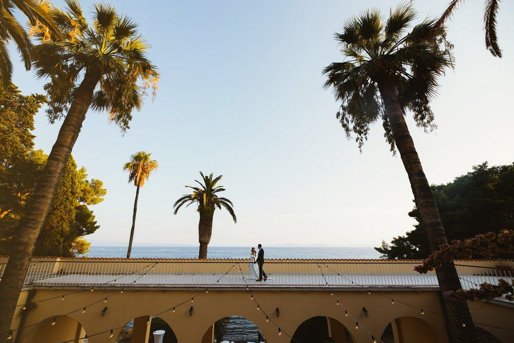 Villa Dalmacija Wedding. Couple walking on the rooftop of the venue.