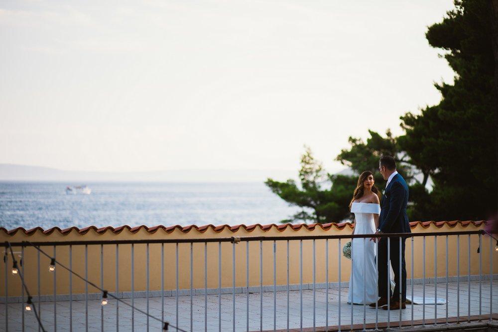 Newlyweds walking after their wedding ceremony at Villa Dalmacija