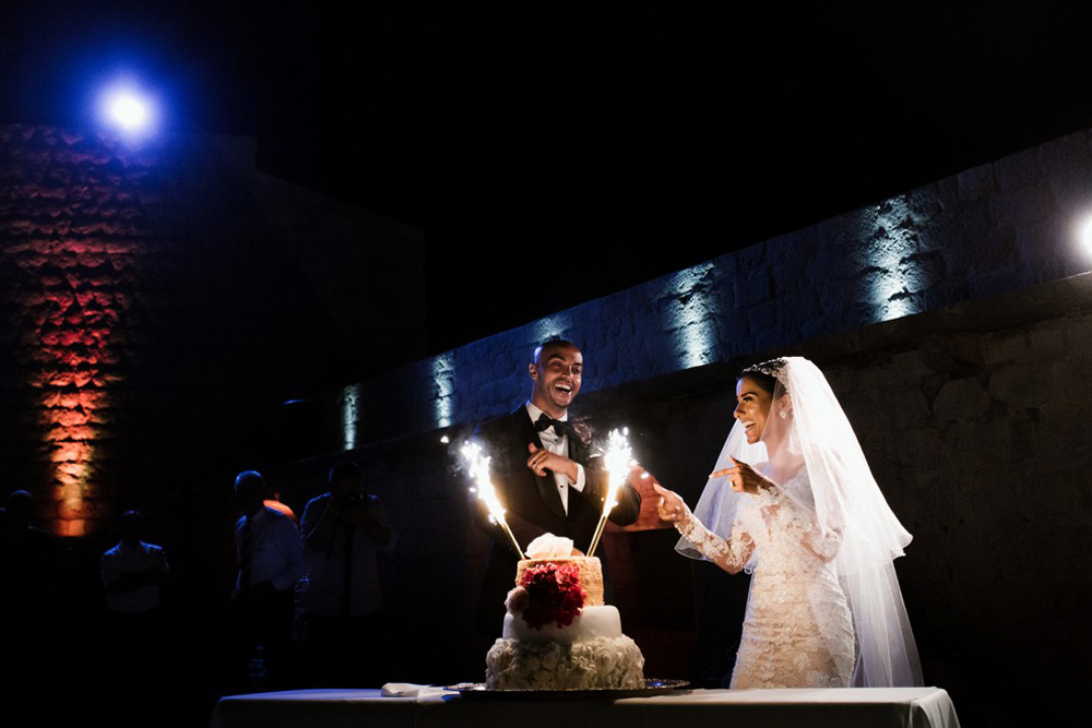 Cutting Cake at top of Lovrijenac Fortress, Dubrovnik's Epic Wedding Venue