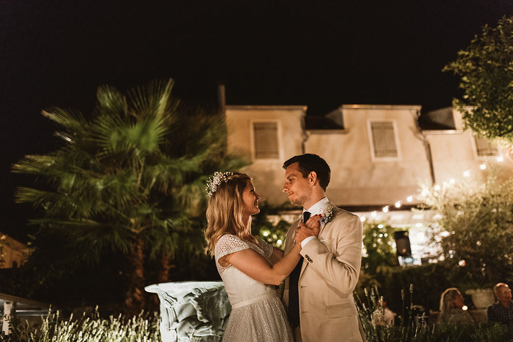 Newlyweds dancing under the stars on the terrace of Lola restaurant, beautiful outoor wedding venue on Vis Island.
